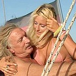 Blonde hottie heads down and gets her pussy nailed on a boat